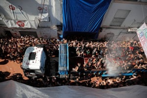 Tomatoes are thrown from a lorry at La Tomatina in Spain