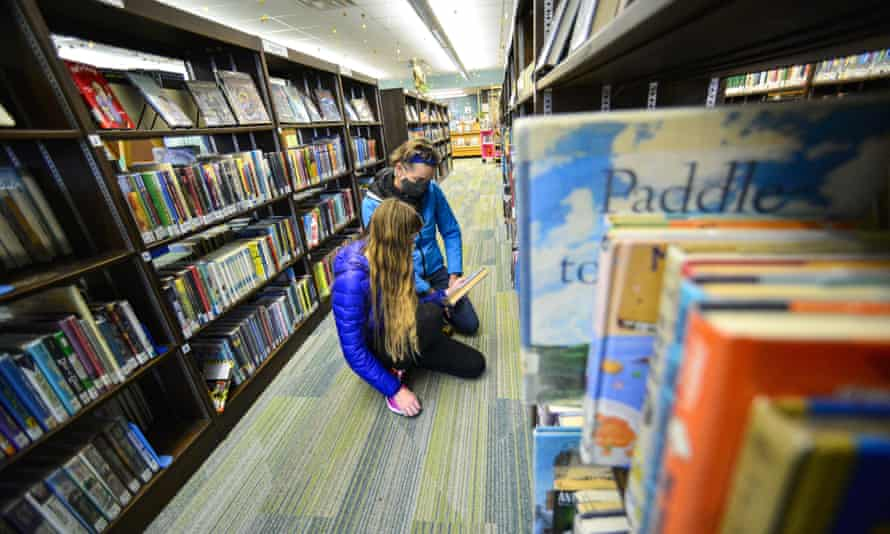 A mother and daughter look for a book at the Brooks Memorial Library, in Brattleboro, Vt. US