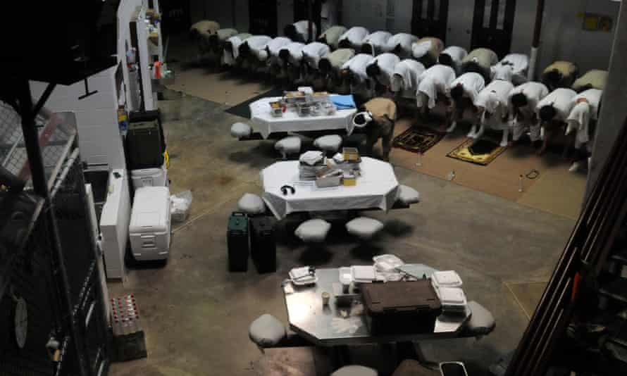 Detainees pray in a communal area of Camp Six in 2011.