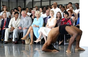 Prince Charles and Camilla, Duchess of Cornwall, with Carlos Acosta, watch a performance during a visit to the Acosta Dance Company in Havana