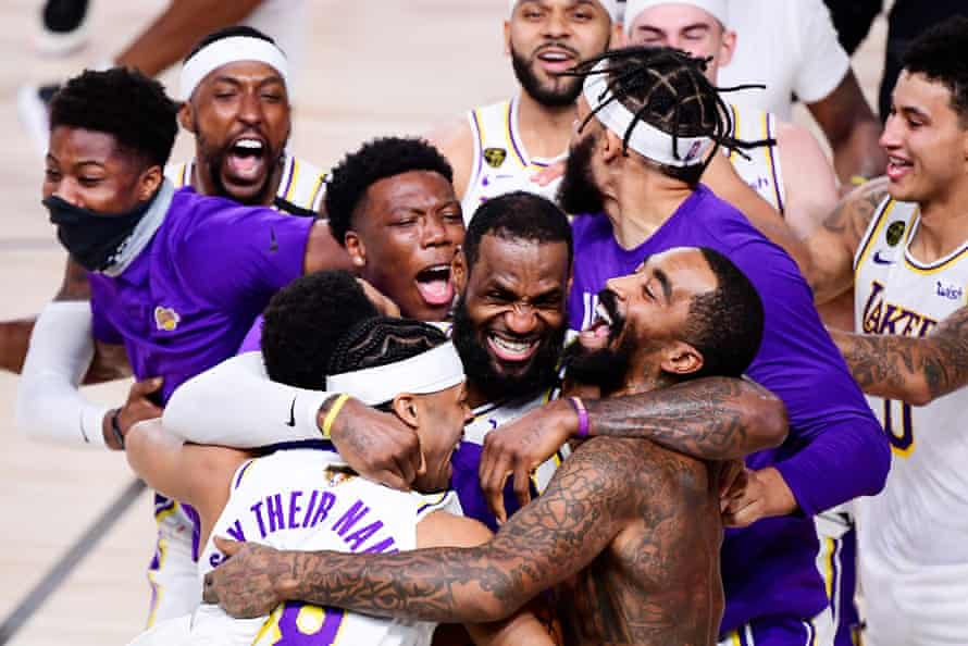 LeBron James of the Los Angeles Lakers celebrates with Quinn Cook and his teammates after winning the NBA Championship at AdventHealth Arena in Lake Buena Vista on 11 October.