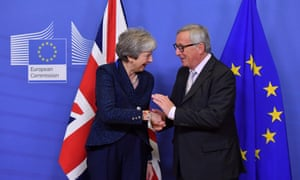 Theresa May greets EU president Jean-Claude Juncker in Brussels on Saturday.