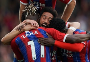 Andros Townsend of Crystal Palace celebrates scoring the second goal with Wilfried Zaha and Jeffrey Schlupp.