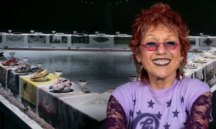 Judy Chicago in front of The Dinner Party