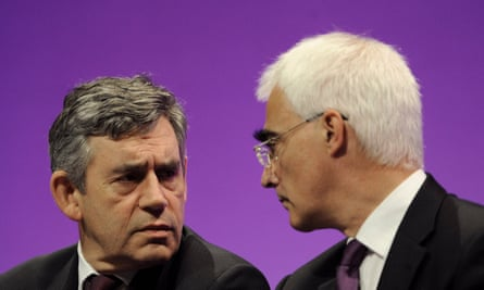 Prime minister Gordon Brown speaks to the chancellor of the exchequer, Alistair Darling, during the Labour party conference in Manchester in September 2008.