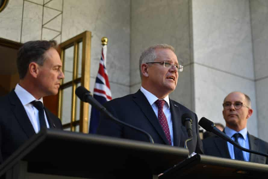 Minister for health Greg Hunt, prime minister Scott Morrison and deputy chief medical officer Paul Kelly give a coronavirus update on 27 February.