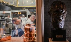 Staff work in the kitchen of Paul Bocuse's restaurant Auberge du Pont de Collonges