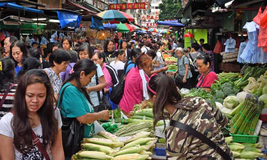 The Temple Street food market in Kowloon, Hong Kong, bustles with activity day and night.