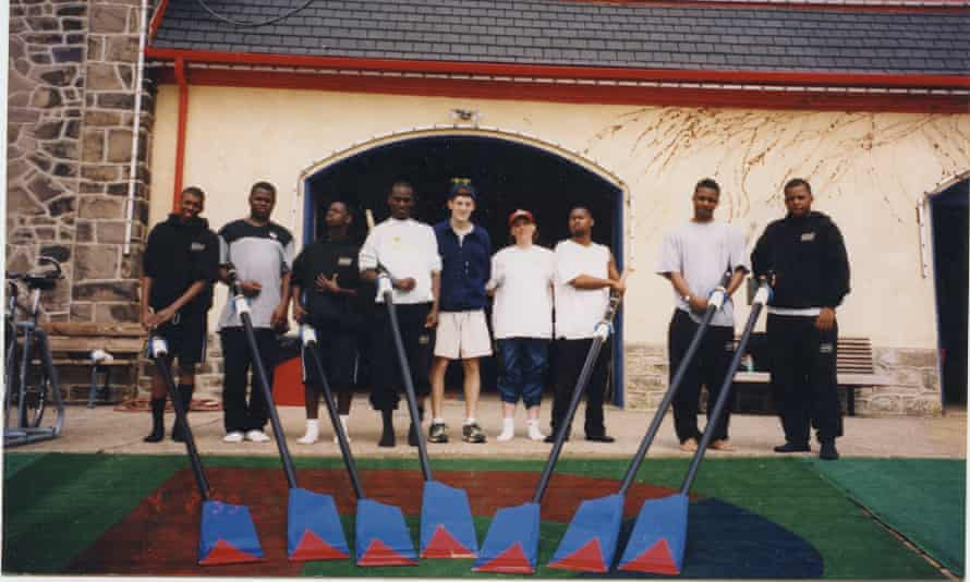 The Manley Crew in front of a boathouse during their original incarnation in 1999
