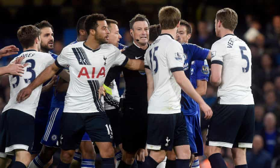 Mark Clattenburg issues a yellow card during an ill-tempered night at Chelsea on which he says he could have sent off three Tottenham players.