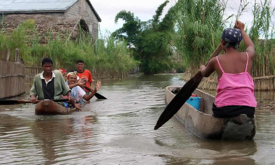 Residents of Anaroro (approximately 150 km northeast of Antananarivo) paddle through the heavily flooded streets of their village on March, 2 2008