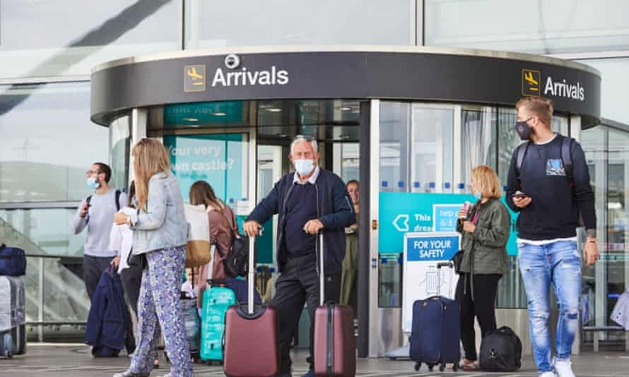 Passengers arrive at London Stansted airport, owned by Manchester Airports Group.