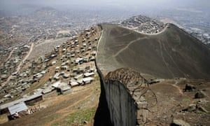 A wall dividing shanty towns and rich neighbourhoods in Lima, Peru, where Kim's journey to the World Bank began.
