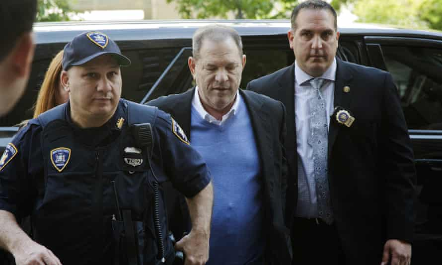 Nicholas DiGaudio, right, escorts Harvey Weinstein into court in New York on 25 May. DiGaudio apparently coached a witness to delete information before handing her phone to prosecutors.