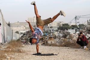 Ahmad Abusrour does a cartwheel at Aida camp