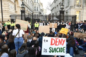 Protesters outside the gates of Downing Street on Friday