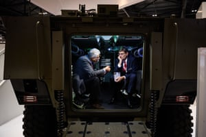 London, England: Two men talk inside an armoured personnel carrier