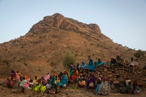 After fleeing a government-led attack on the town of Golo, women and their children wake up on the side of a mountain where they hide outside of Kome, central Darfur