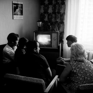 A family in Moscow watch brief taped excerpts of the Apollo 11 moon landing broadcast on Soviet television the following day, 21 July 1969.