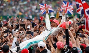 Lewis Hamilton celebrates with fans after winning last year's British Grand Prix but the 2020 calendar has been unpicked amid the coronavirus pandemic.