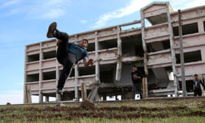 Ibrahim Eid, 16, demonstrates his Parkour skills in front of damaged building in the rebel-held city of Inkhil, west of Deraa, Syria, February 4, 2017.
