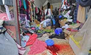 Blood stains the floor of a clothes shop after Russian airstrikes in the rebel-hold town of Muhambal, south-west of Idlib