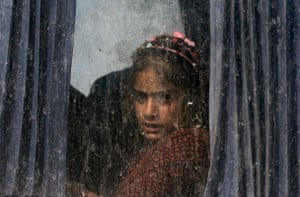 A girl sits in a bus transporting displaced families from a camp in Habbaniyah.