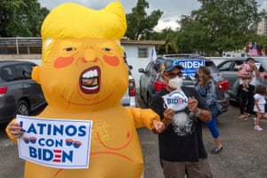 Masked while protesting. Joe Biden supporters in Little Havana, Miami, demonstrate against Donald Trump's visit to south Florida yesterday, when he barely mentioned coronavirus despite record cases and deaths in the state and the situation there worsening.