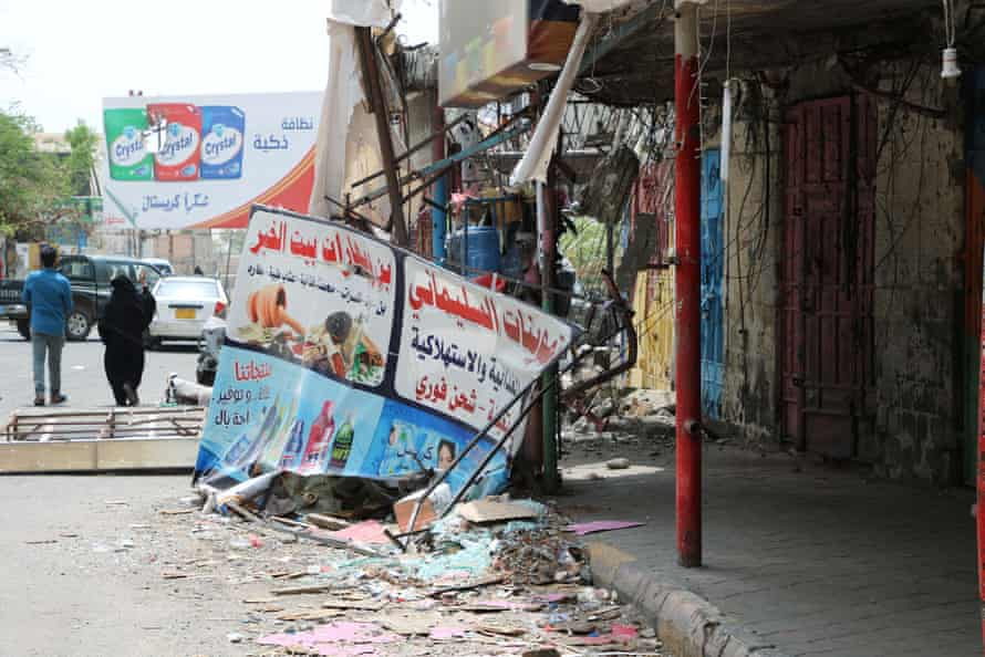 Shops damaged during clashes between separatists and government forces in Aden