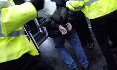 Police arrest a suspect in an early morning drugs raid