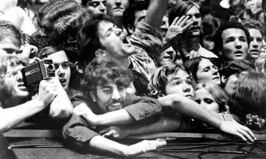 Fans in the audience watching the Rolling Stones concert at Altamont Speedway, in December 1969.