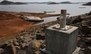 A boat moor post shows a water level reference at Guri dam in Bolivar state, where drought has turned parts of one of the world's biggest dams into desert.