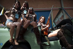 Colombian women pose on a 1974 Land Rover during the classic cars parade in Medellin, Antioquia in 2013