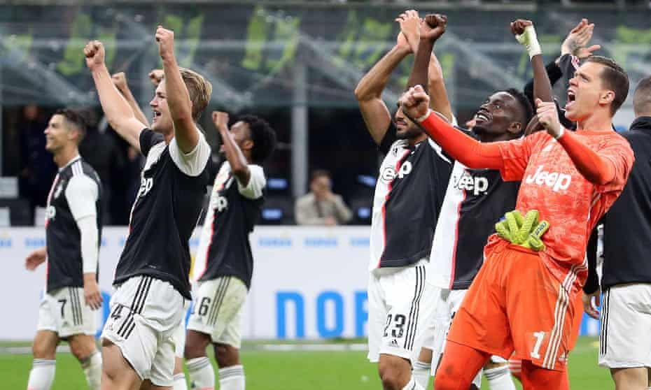 Juventus players celebrate after their victory over Inter.