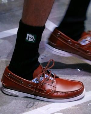 Prada deck shoes with tube socks.