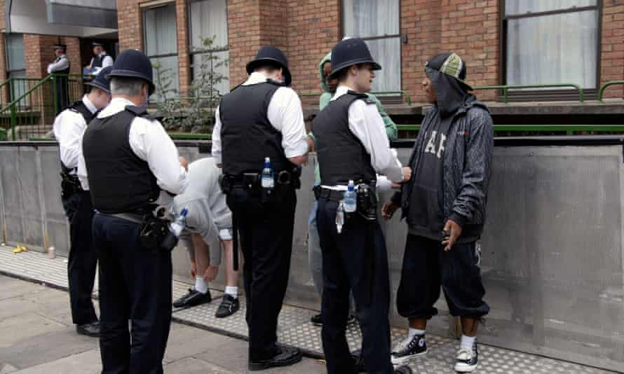 Men being stopped and searched in Notting Hill, west London.
