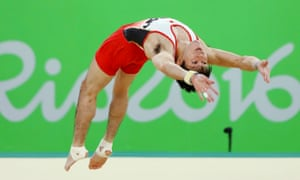 Kohei Uchimura competes on the floor to help Japan take gold in the men's team gymnastics final.