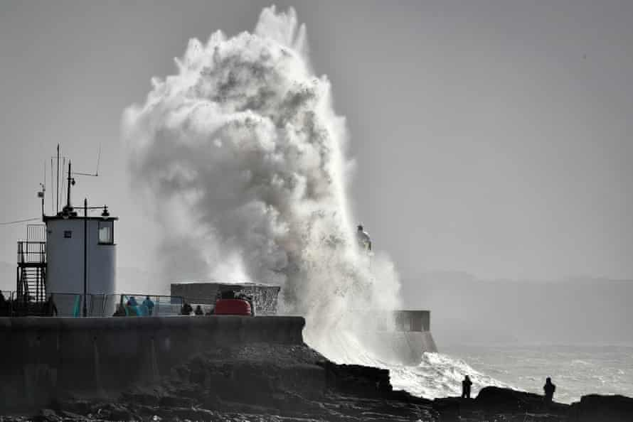 Huge waves at Porthcawl, Wales: there will be more extreme storms and longer droughts.