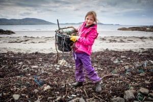 A pupil from Ulver primary school takes part in a beach clean at Kilninian beach, Isle of Mull.