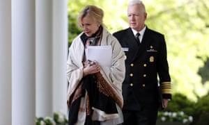 Dr Deborah Birx and Brett Giroir walk to the Rose Garden to attend a coronavirus briefing with Donald Trump, 27 April 2020.