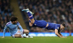 Chelsea's Mateo Kovacic in action with Manchester City's David Silva.