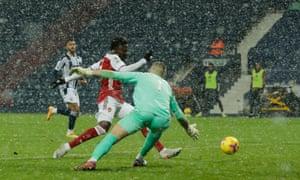 Bukayo Saka of Arsenal scores.