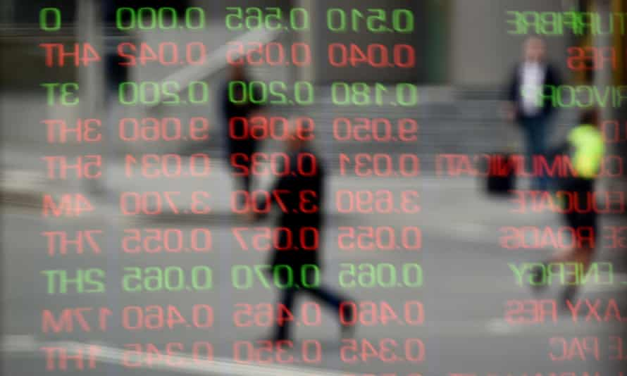Stocks are reflected on the window at the Australian Securities Exchange in Sydney on 24 June 2016 in the aftermath of Britain's decision to leave the European Union.