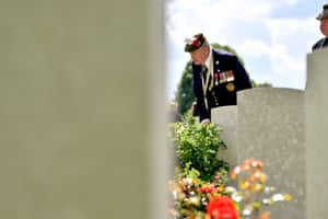 John Lamont, a Scottish war veteran, looks at graves in Bayeux, Normandy