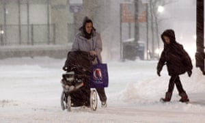 A family walks up Front Street during a snow storm in Worcester, Massachusetts.