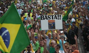A sign reads 'Basta!!' (Enough!!) as thousands of demonstrators pack the Copacabana beach calling for the impeachment of President Dilma Rousseff.