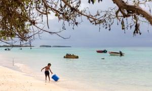 A child plays on a beach in the Funafuti lagoon in Tuvalu