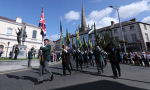 Veterans pass by the Ulster Defence Regiment memorial in Lisburn.