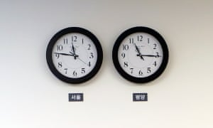 Seoul time zone clock (L) and Pyongyang time zone clock (R) at the demilitarised zone in the border village of Panmunjom, South Korea. North Korea has now changed its time zone to match the South.
