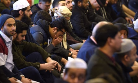 Worshippers at Birmingham central mosque observe a minute's silence for the victims of the Westminster attack